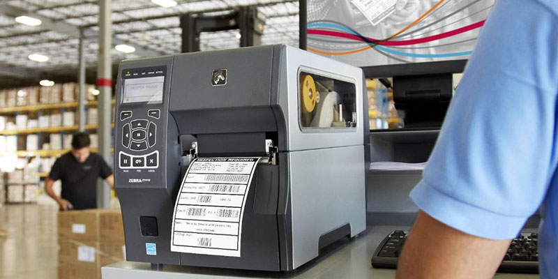 Printer printing a barcode in a warehouse