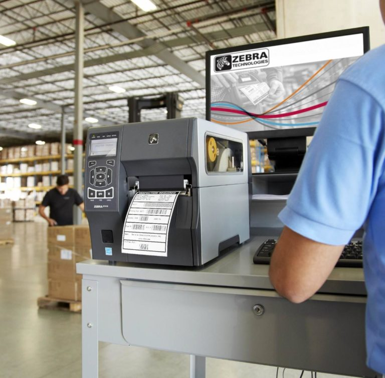 ZT410 RFID Printer printing a barcode in a Warehouse