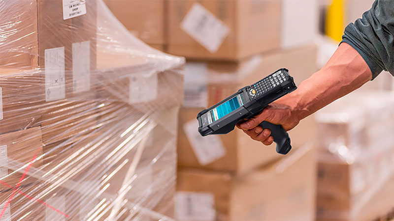 The Zebra MC9300 Scanning Barcodes Cardboard Boxes