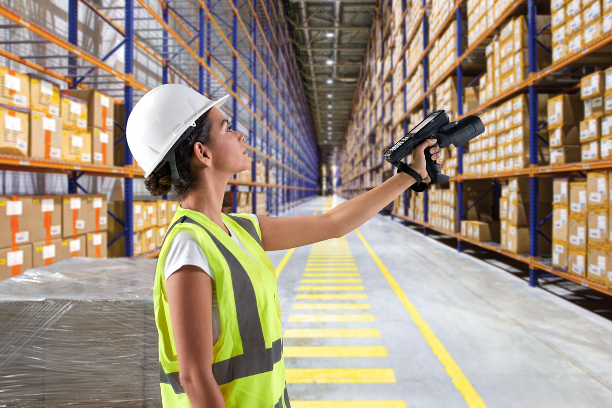 Woman Scanning Warehouse Inventory with MC3390R